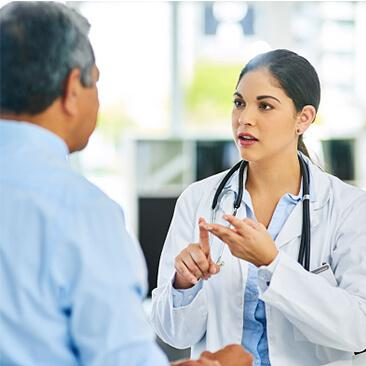 Doctor speaking with a patient
