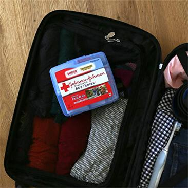 Johnson & Johnson SAFE TRAVELS® First Aid Kit in a suitcase