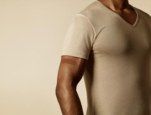 Male wearing skin toned adhesive bandage